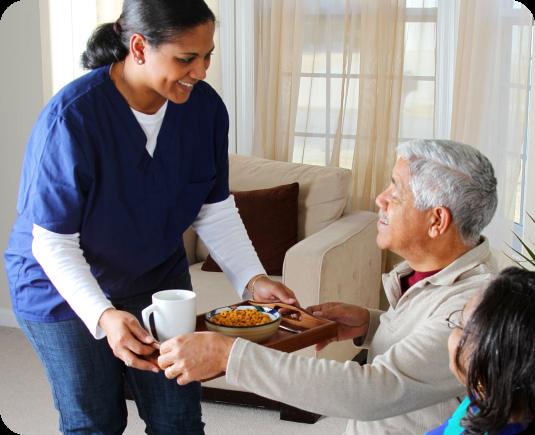 caregiver serving her old patient