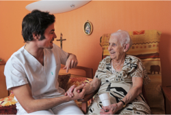 caregiver talking to his patient